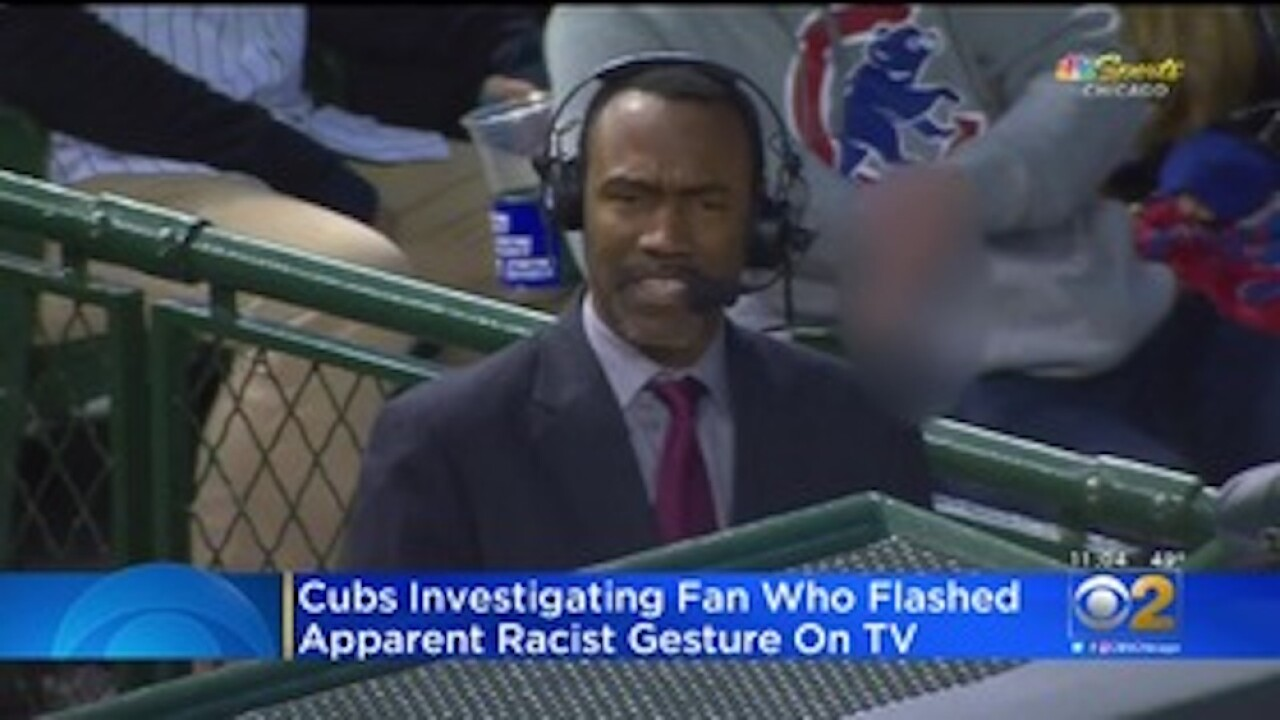 Cubs ban fan from Wrigley Field indefinitely after he made a 'white power' gesture behind black man