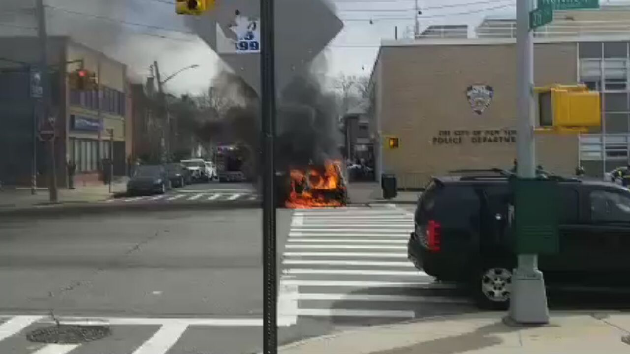 Half-naked man with a knife shot by police after setting car on fire at NYPD precinct