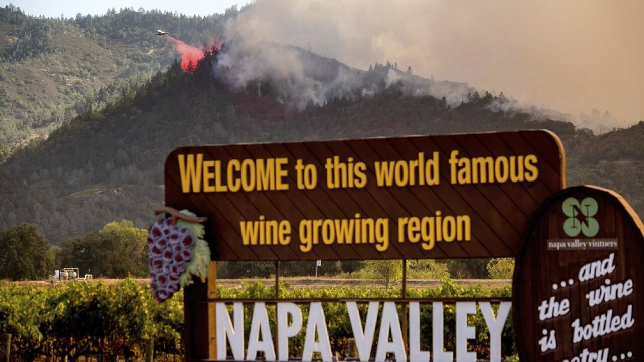 An air tanker drops retardant on the Glass Fire burning in Calistoga, Calif., on Sunday, Sept. 27, 2020. (AP Photo/Noah Berger)