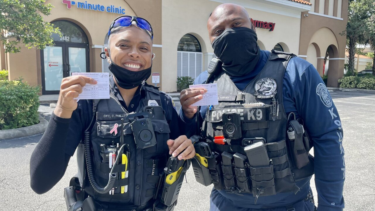 Riviera Beach police officers Javares Harvey and Cheris Phillips decided to get the Moderna coronavirus vaccine on Thursday.