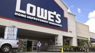 Lowe's to give employees temporary pay raises, stores to close early daily