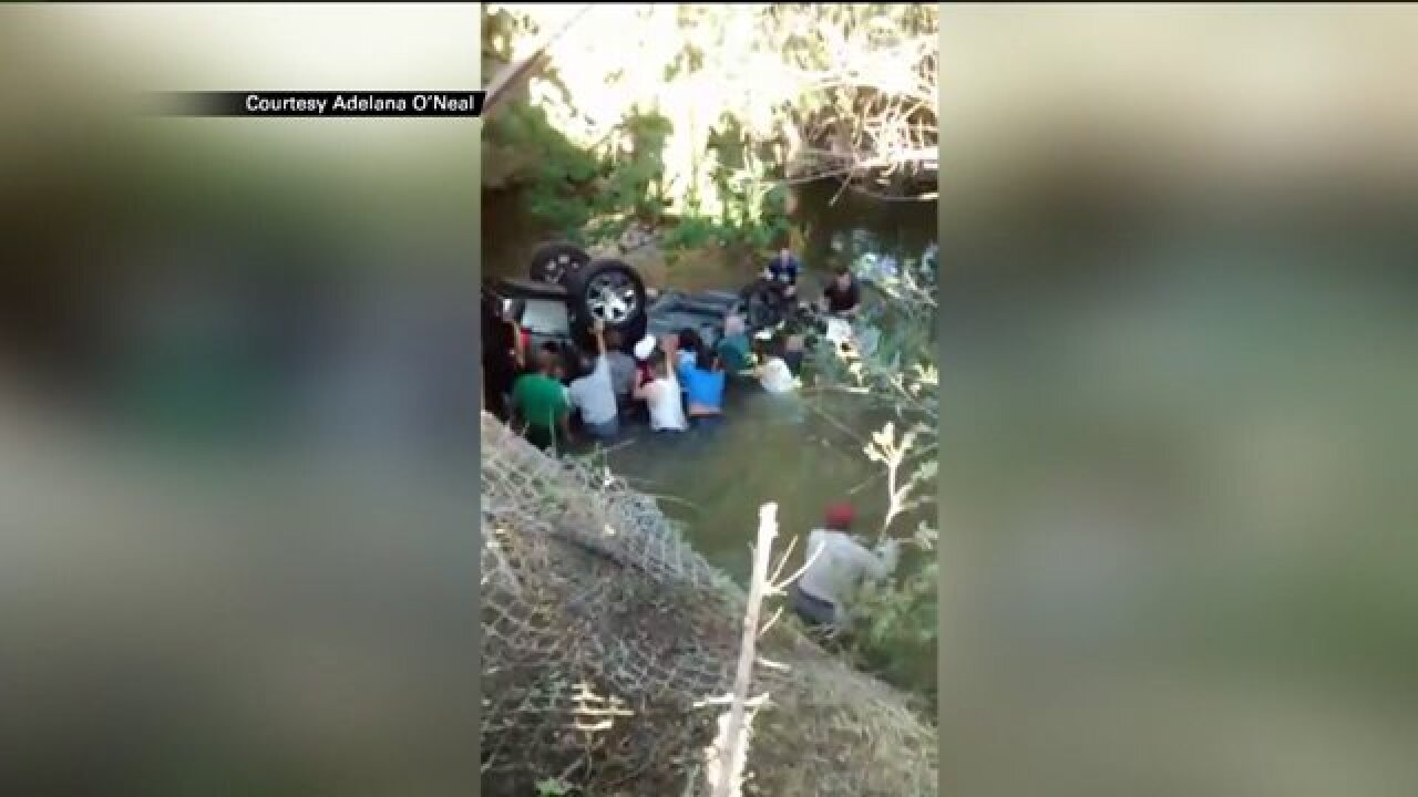 Video: Bystanders jump into river to save passengers after SUV flipped intowater