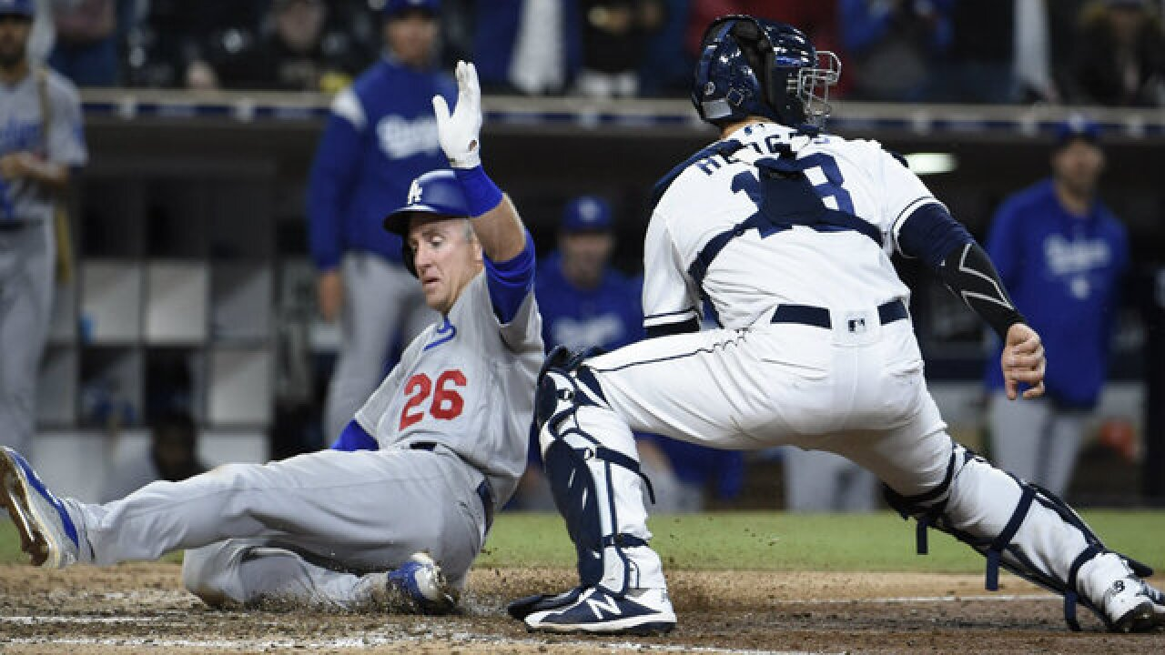Padres rally to send game into extra innings but fall to Dodgers 7-3