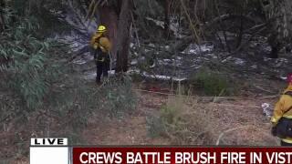 Crews battle brush fire in Vista