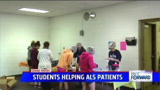 Local students help prepare care packages for ALS patients