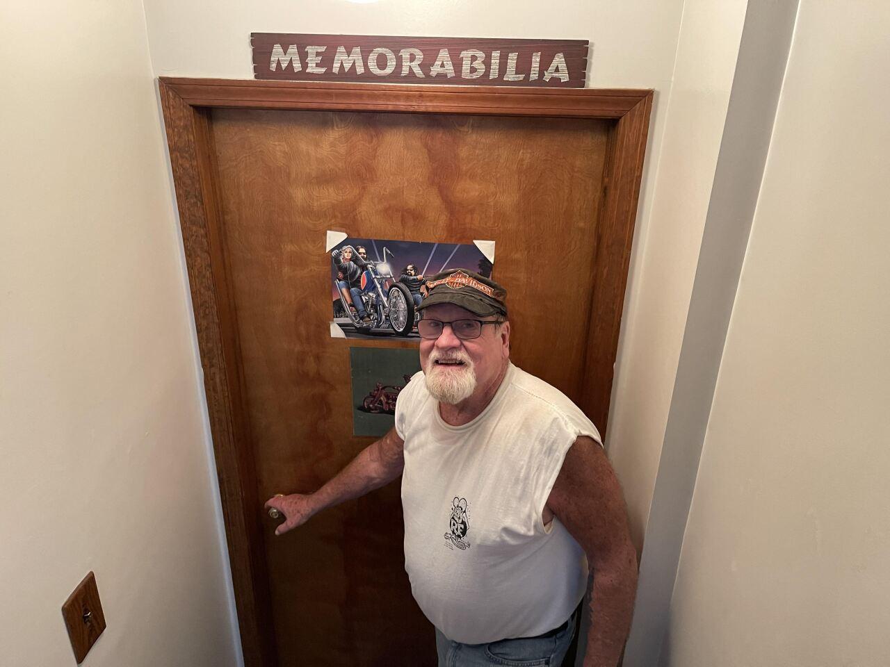 Wayne Caveney getting ready to open the door to his basement .jpeg