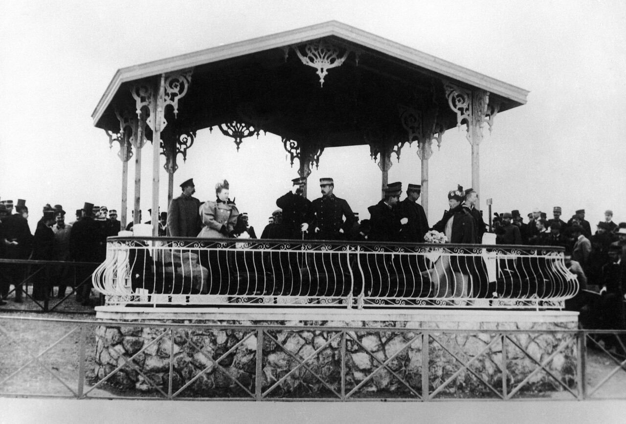 The Greek royal family at the opening of cycling events at the first modern International Summer Olympic Games held at the Neo Phaliron Velodrome on April 8, 1896 in Athens, Greece. Saluting at center is Greek King George and Crown Prince Constantine I at right. (AP Photo)