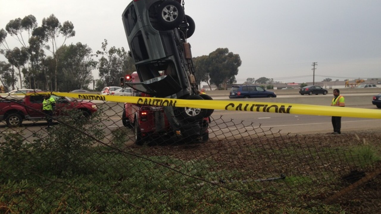 SUV fllies off freeway, lands on nose