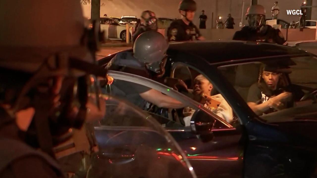 Video shows Atlanta police using stun guns to take 2 in car into custody