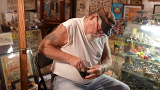 Wayne Caveney is winding up one of his collectible toys.