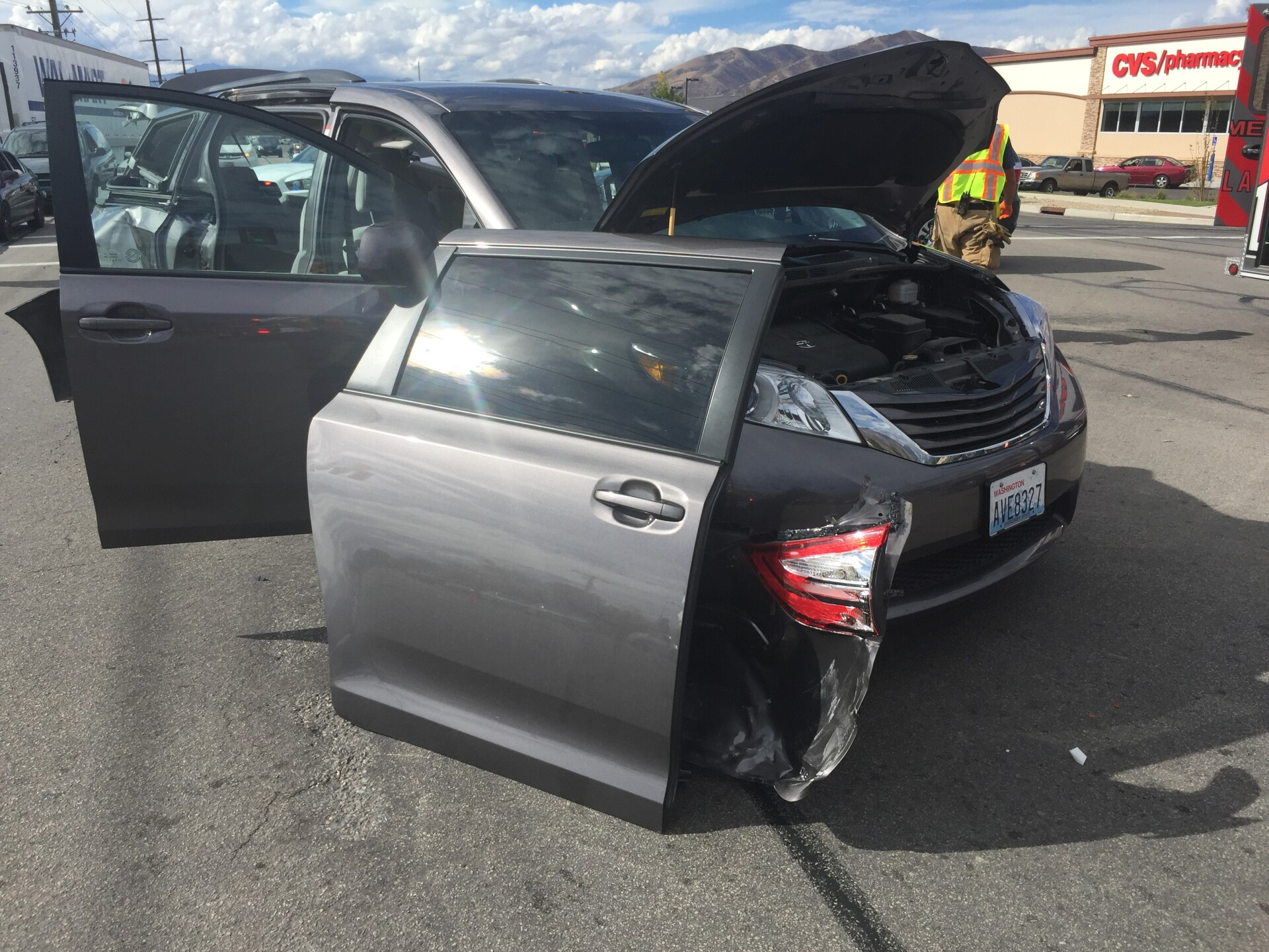 Photos: Woman in critical condition after van rear-ended inHighland