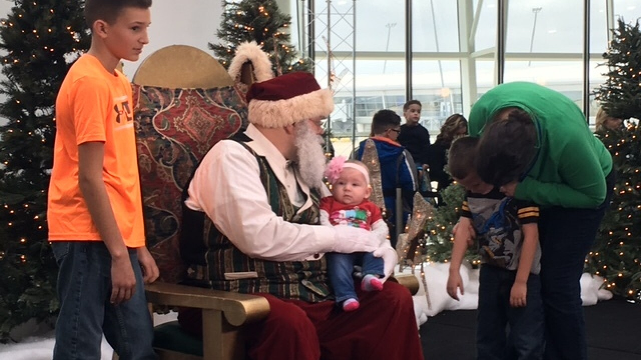 PHOTOS: Santa arrives at Indy airport