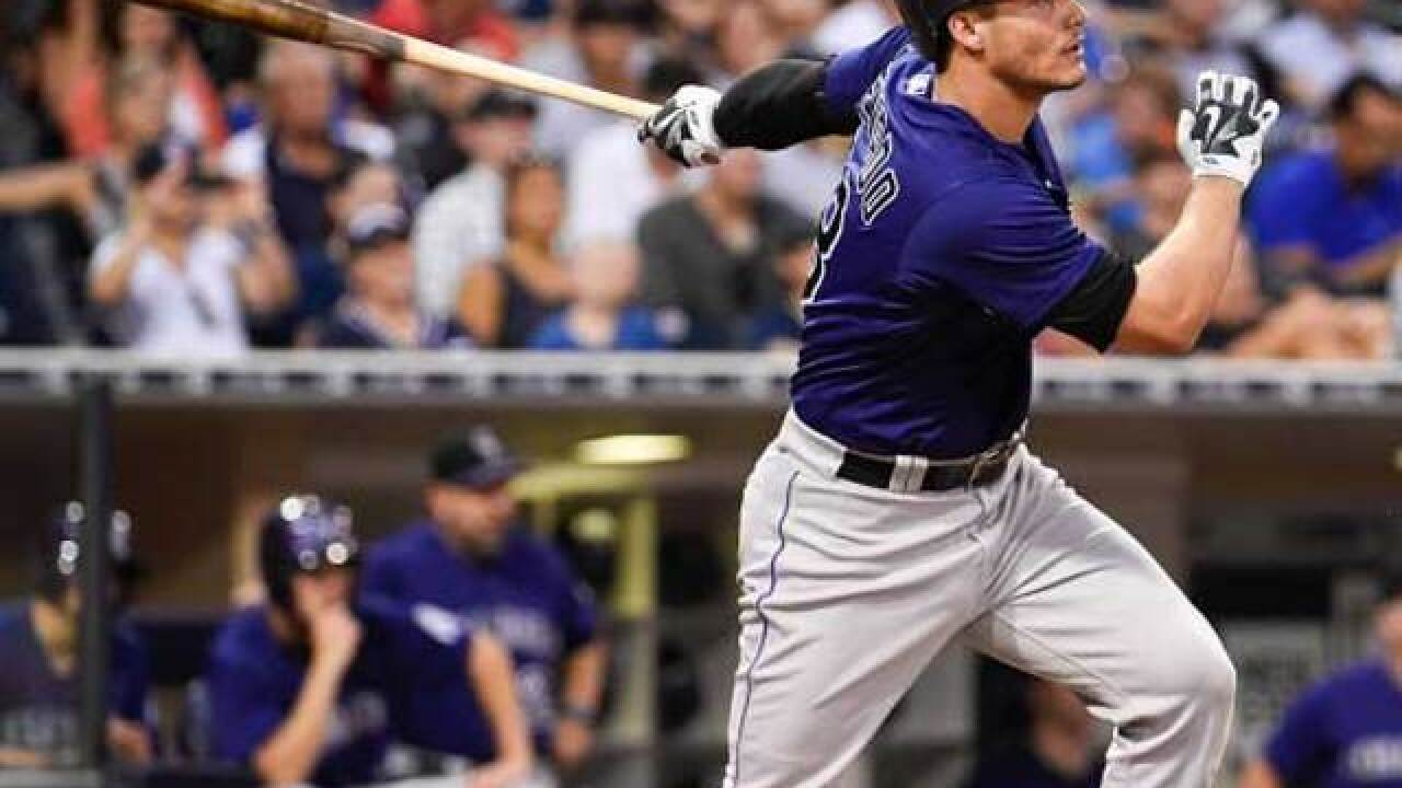 Arenado hits 2 homers, Chatwood gets the win