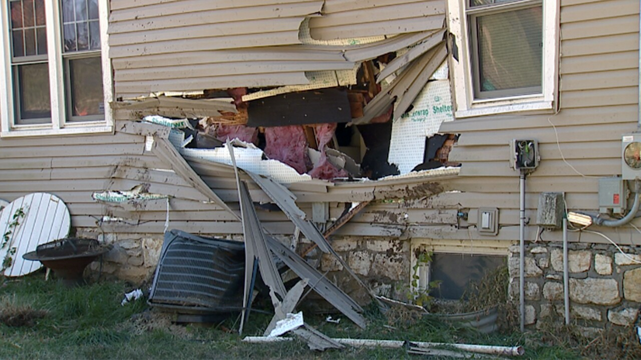 raytown crash into house.jpg