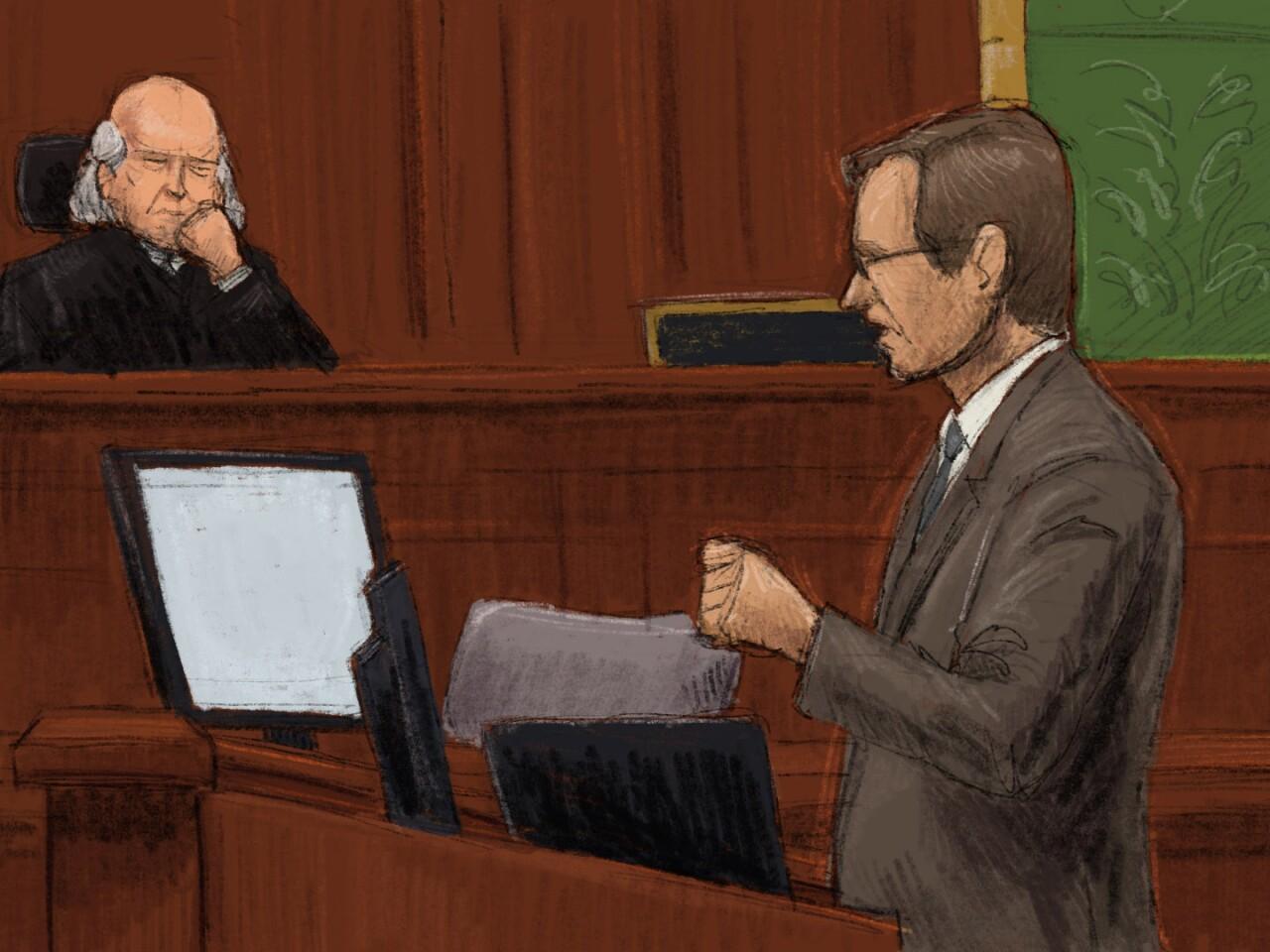 Assistant U.S. Attorney Tim Mangan argues before U.S. District Court Judge Michael Barrett.