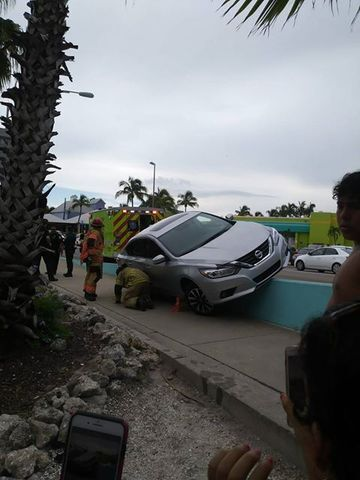 Car crashes onto wall on Mantanzas Pass Bridge