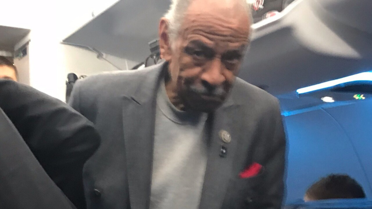 As scandal rages Conyers flies home to Detroit