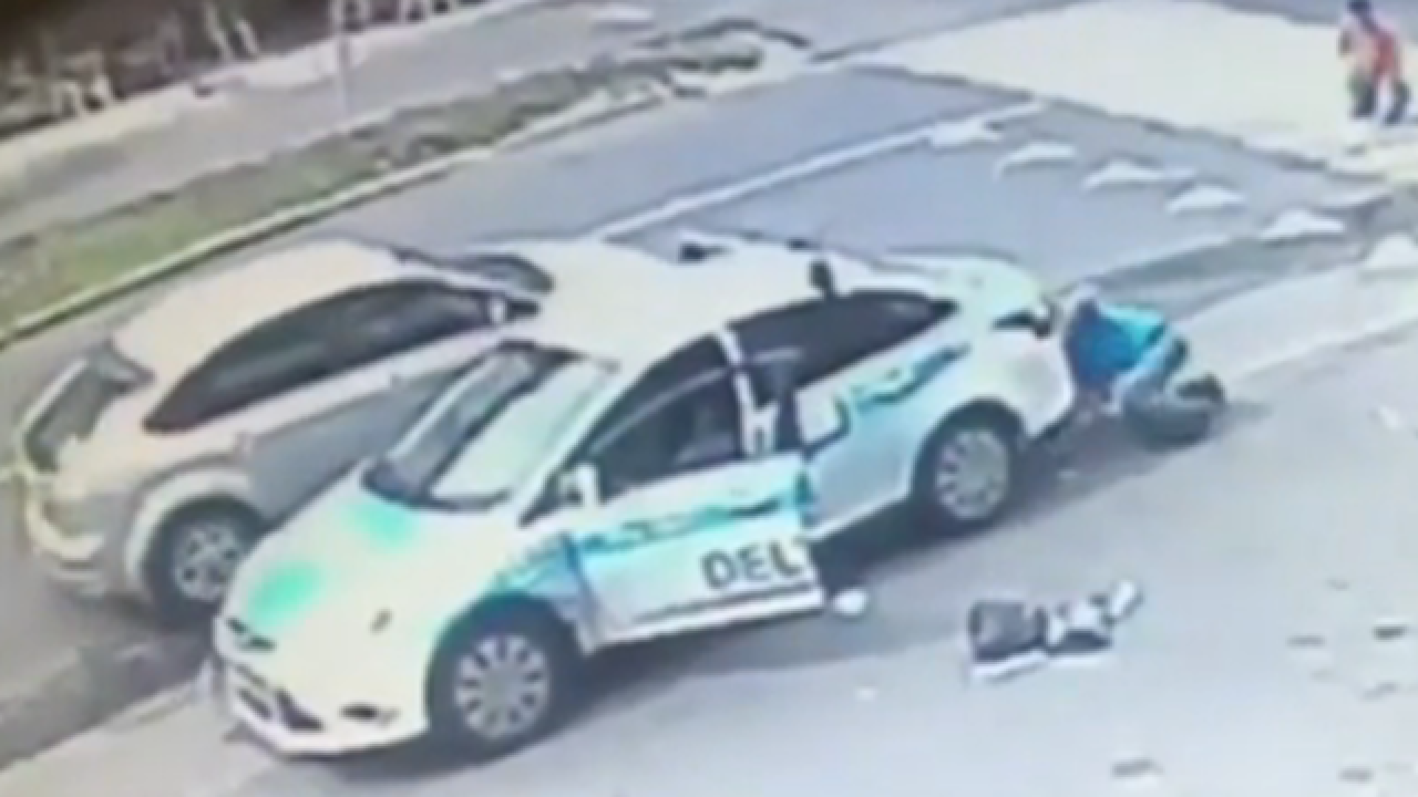 Bystanders rush to rescue little girl run over by car