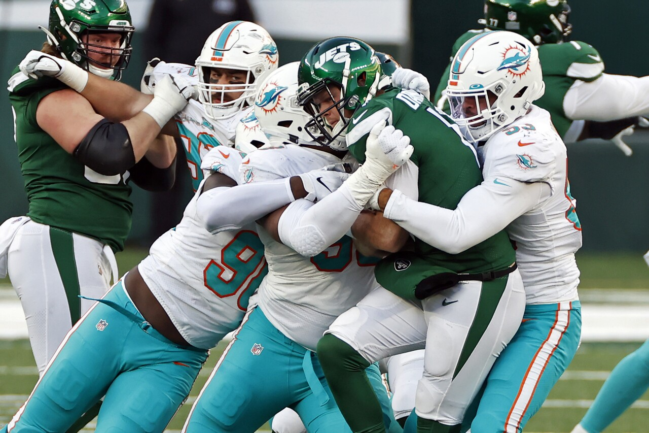 New York Jets QB Sam Darnold sacked by Miami Dolphins defenders in November 2020