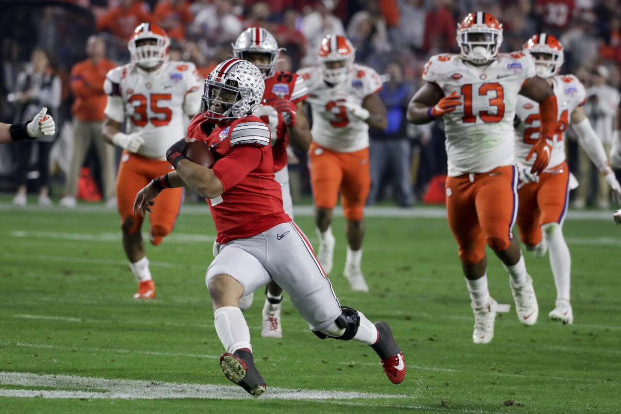 Ohio State Buckeyes QB Justin Fields runs from Clemson Tigers during College Football Playoff semifinal at Fiesta Bowl, Dec. 28, 2019
