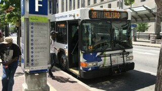 Cincinnati Metro Rt. 28 bus pulls up to its stop at Government Square, photographed July 2017.