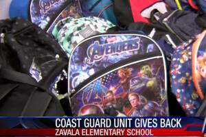 Coast Guard surpasses hands out backpacks to students