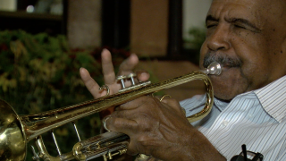 Dr. Hugh Ragin playing the trumpet in Larimer Square