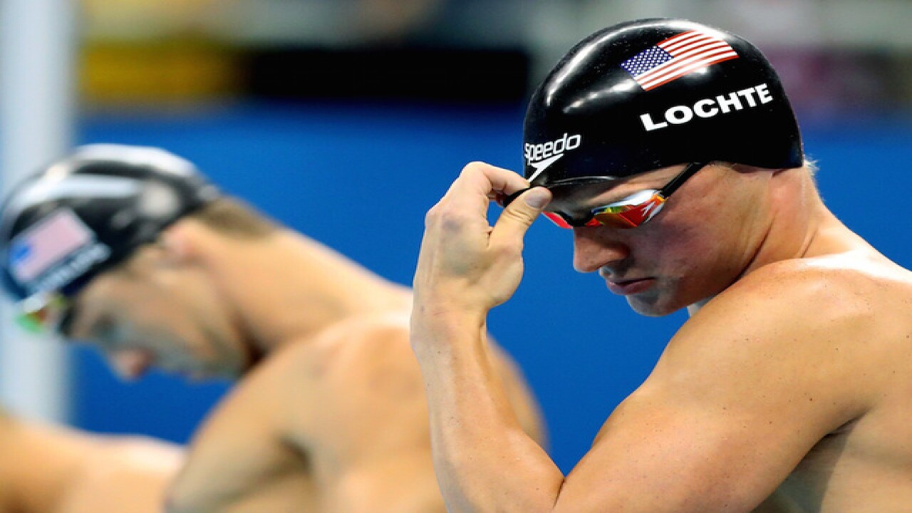 US swimmers removed from flight