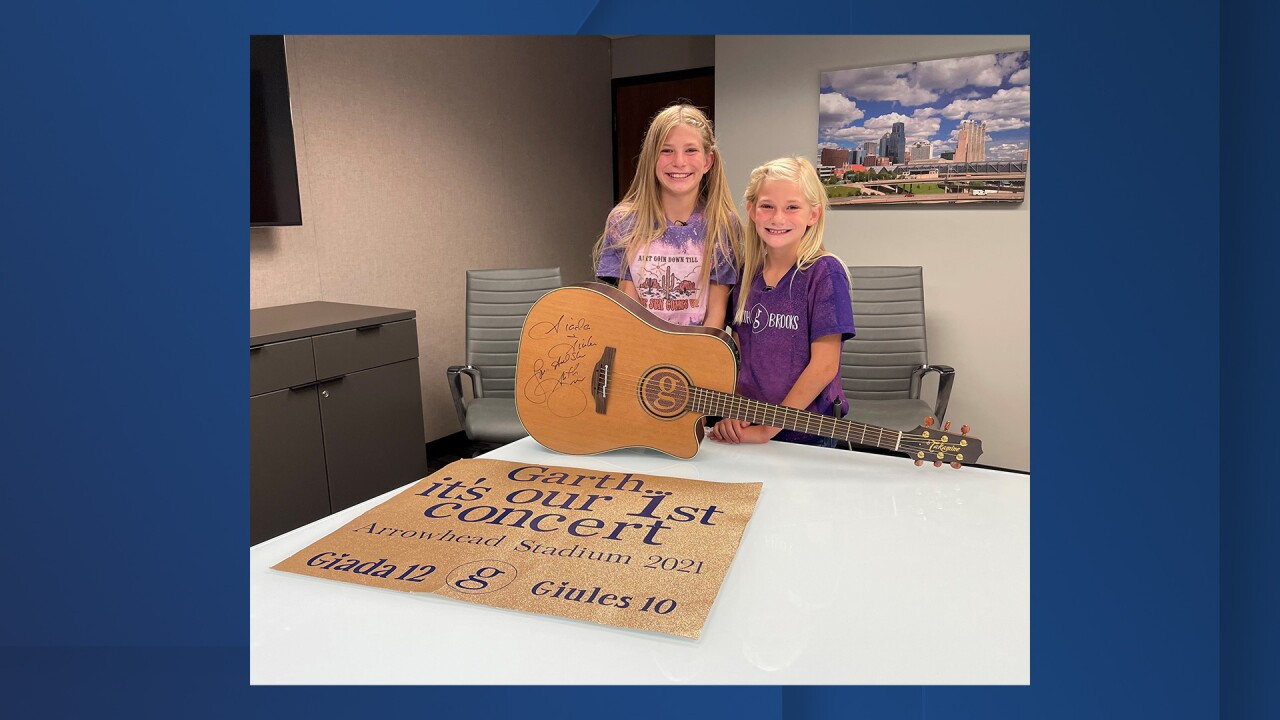 Kansas sisters receive Garth Brooks signed guitar