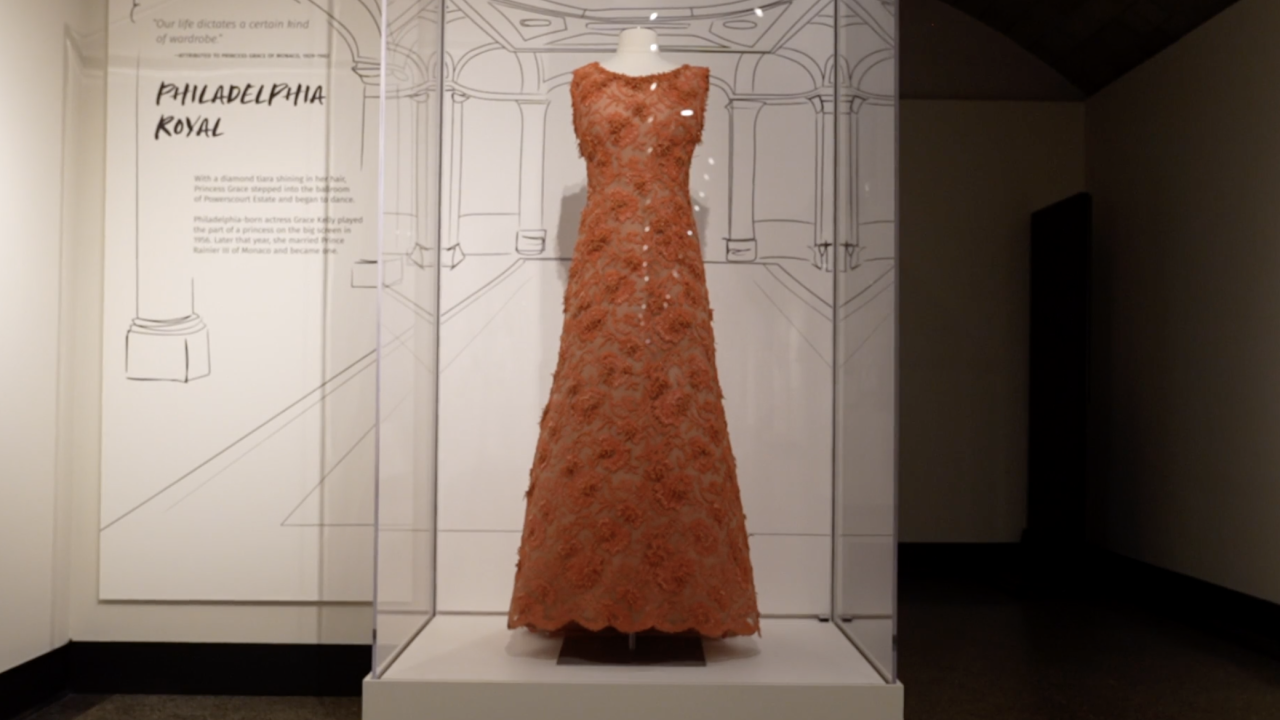 This gown, made with pieces of coral, was once worn by Grace Kelly, the Hollywood star who went on to become the Princess of Monaco. She is also a Philadelphia native and her dress is now on display at the Penn Museum for the exhibit.