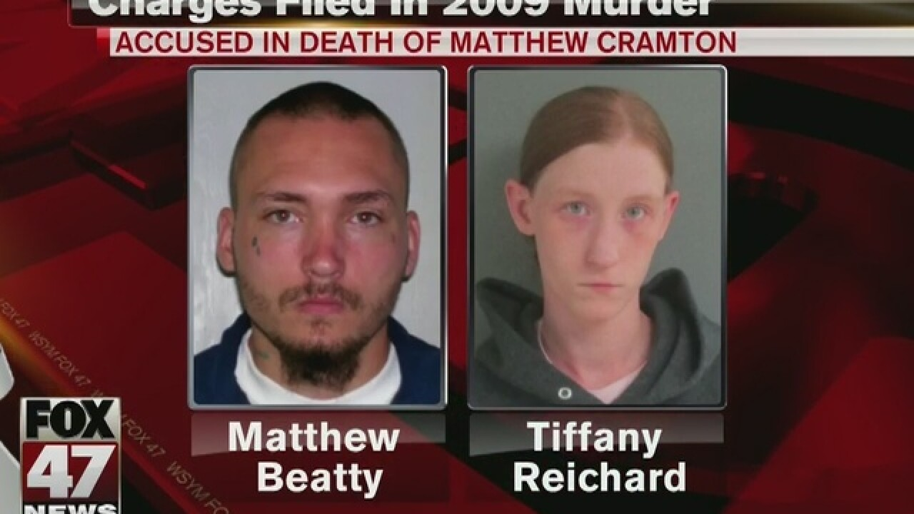 Two people charged in 2009 stabbing death