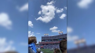 9 shaped cloud appears over Nissan Stadium as Steve McNair has his #9 jersey retired