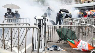 Police use tear gas, water cannons on protesters in Hong Kong