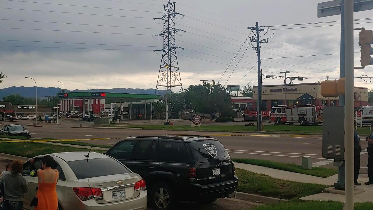 Man climbs transmission tower near Academy and Galley