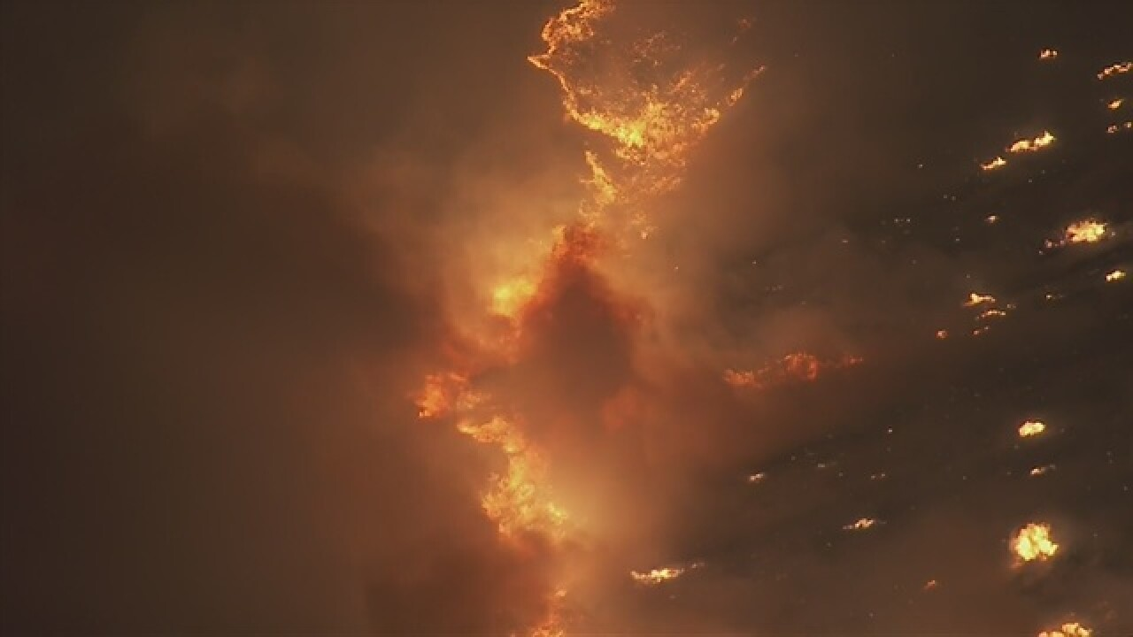Green Mountain brush fire lights up night sky