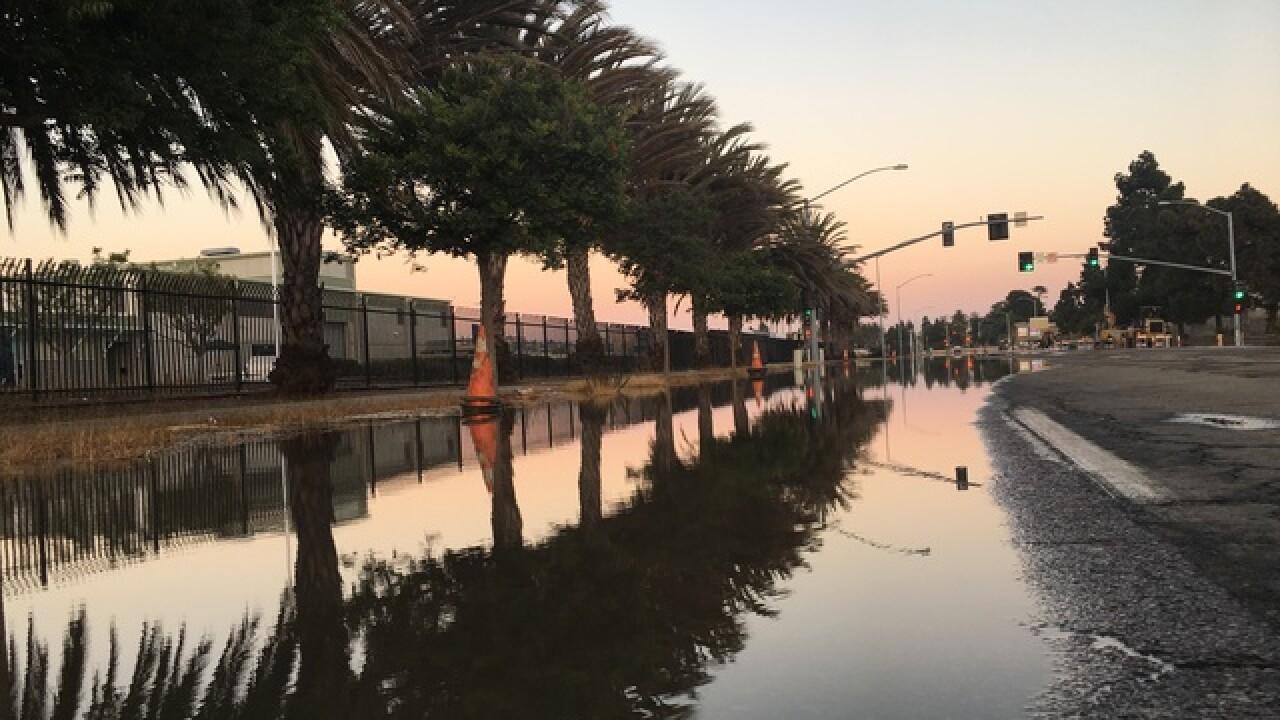 Water main break floods road in Midway District