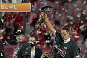 Tampa Bay Buccaneers QB Tom Brady holds Vince Lombardi Trophy after winning Super Bowl LV