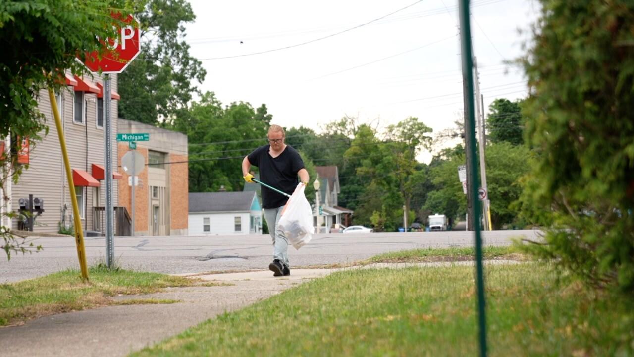 Ryan Kost picking up trash