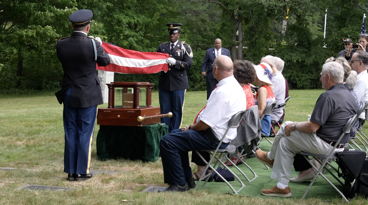 Soldiers were at the burial, folding the flag to present to Parker's family