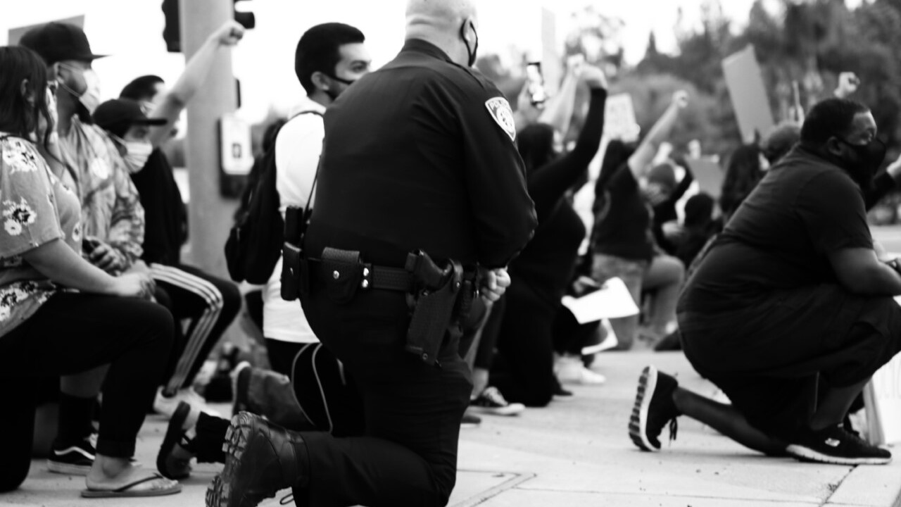 California officers seen taking a knee with anti-police violence protesters