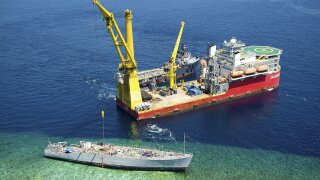Photos: Bow cut from USS Guardian and lifted from Philippinereef