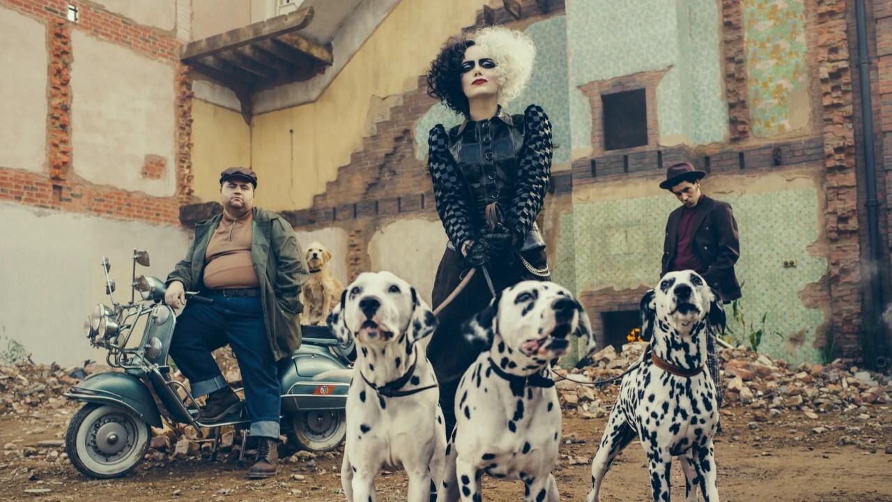 Emma Stone as 'Cruella' and Dalmatians