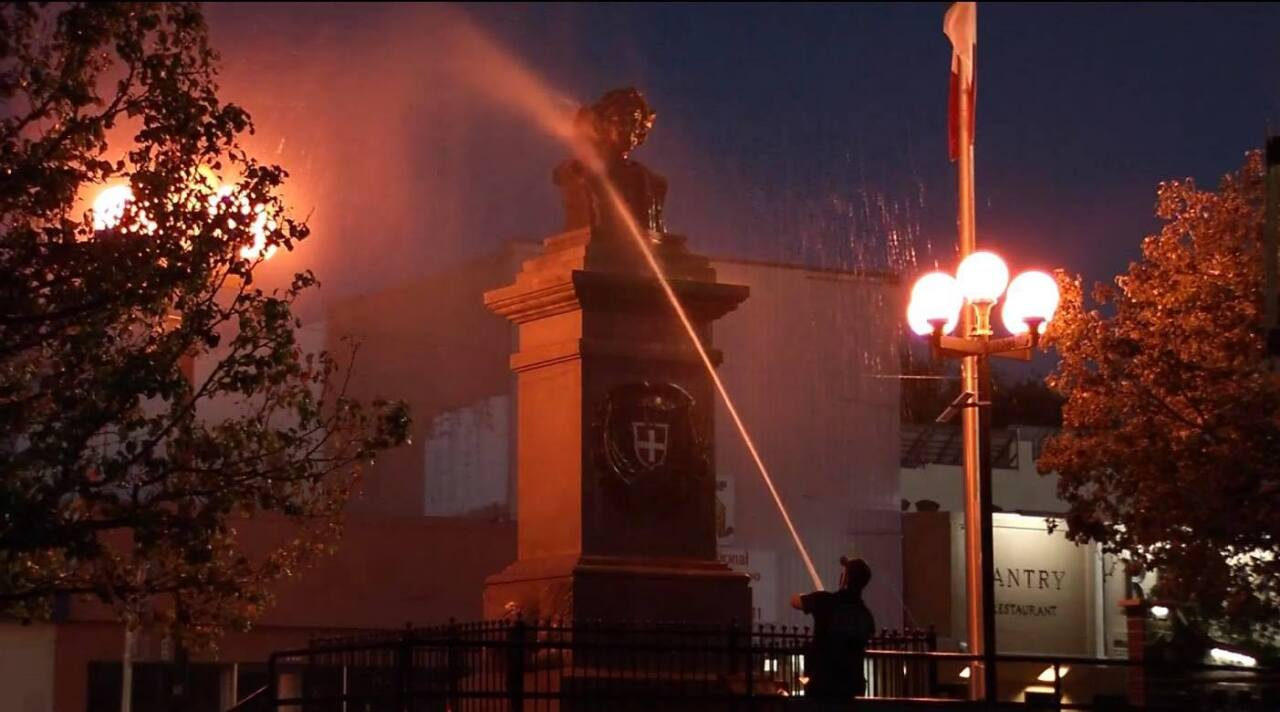 Pueblo Fire Department cleaning up the Christopher Columbus statue in Pueblo on Sunday morning