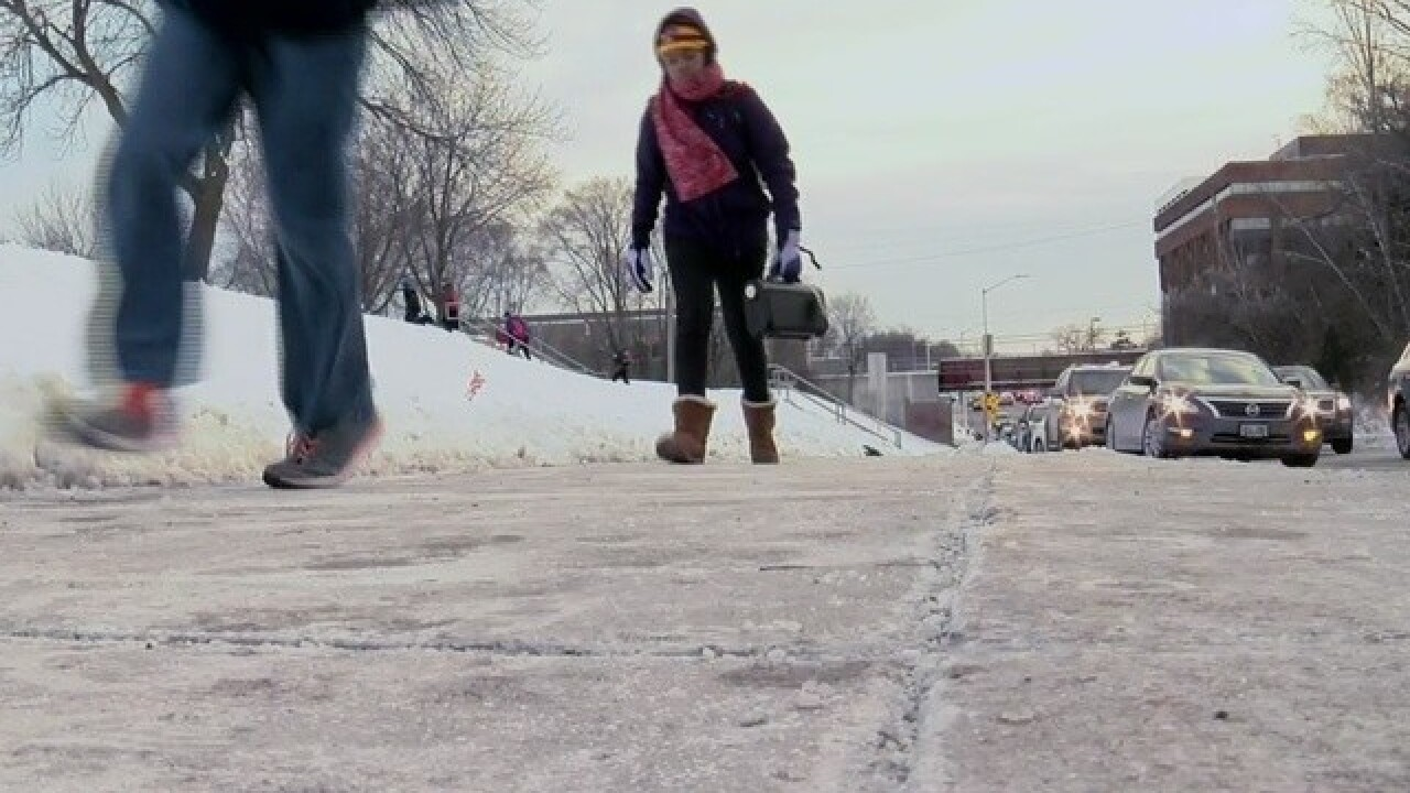 Cold girls, wearing red scarf, walks to school in subzero temperatures