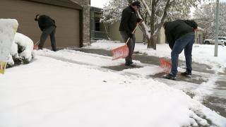 Northglenn Snow Stormers shovel snow.png