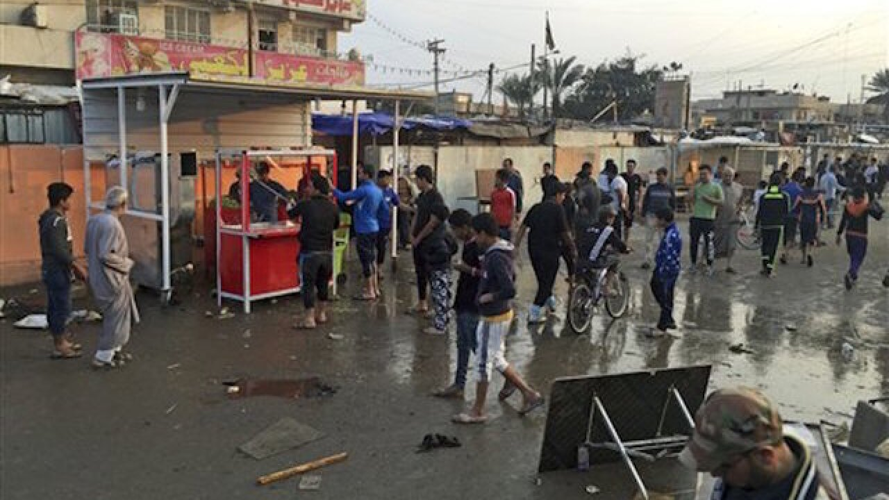 Twin bombing attacks in Baghdad market kill at least 59