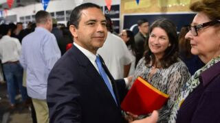 U.S. Rep. Henry Cuellar, D-Laredo, greeted supporters early last year at an event at his campaign headquarters in Laredo..JPG