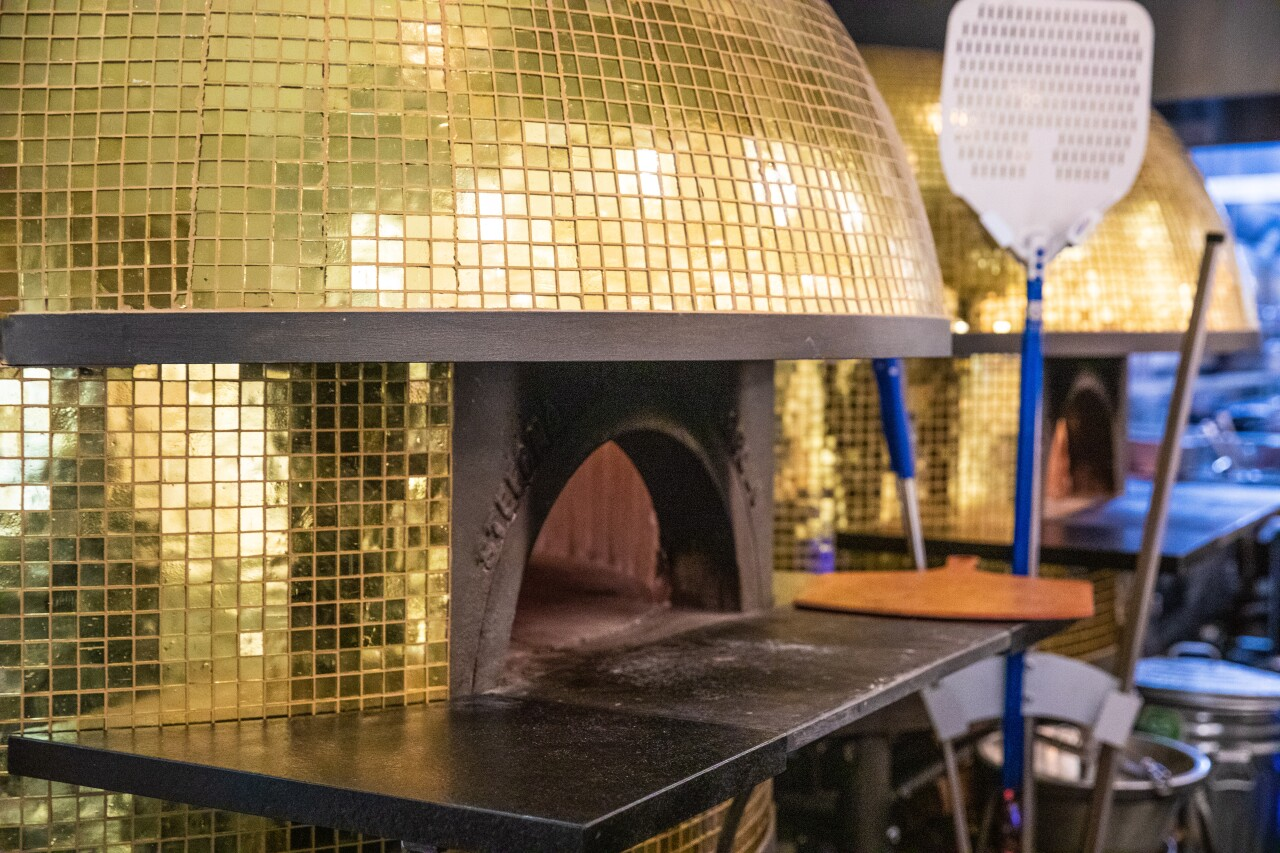 Duel golden-domed pizza ovens that can cook a pie in 70 seconds.