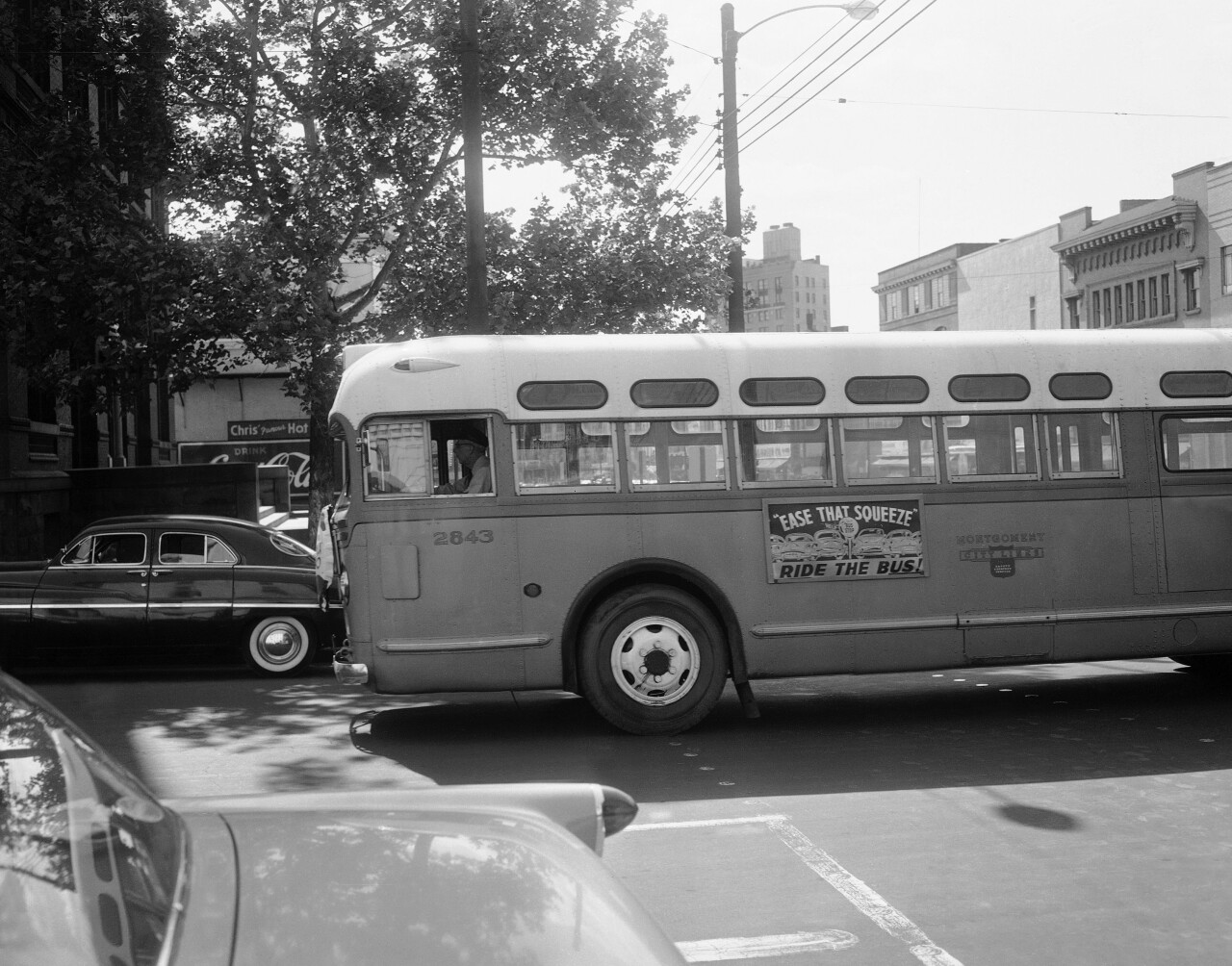 In this April 26, 1956, file photo, a bus driver is all alone as his empty bus moves through downtown Montgomery, Ala, as a boycott continues even though the bus company has ordered an end to segregation. The 60th anniversary of the Montgomery bus boycott is widely credited with helping spark the modern civil rights movement. (AP Photo/Horace Cort, file)