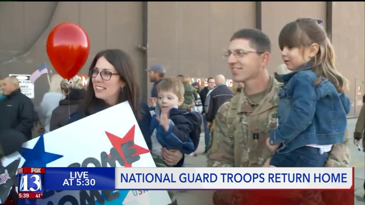 Families express their joy, shed tears as their National Guard troops return home